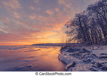 Lake sunrise in the winter