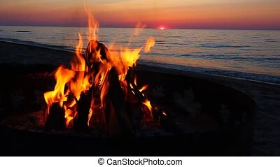 Lake Superior Beach Campfire - Blazing campfire at sunset ...