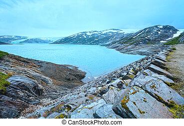 Lake Svartisvatnet and cloudy view to Svartisen Glacier (Meloy, Norway)