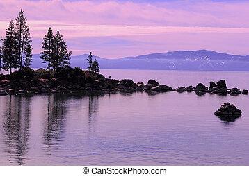 Lake Tahoe, rocks and lake at dusk