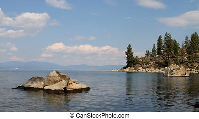 Lake Tahoe Rocky Cove - Tranquil waters ripple along a rocky...