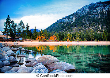 Lake Tahoe - Freshwater lake with mountain in the...