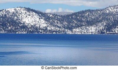 Lake Tahoe with snowy Sierra Nevada mountains