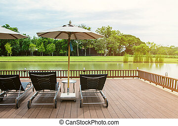 Lake view in summer with relaxation seat in wooden terrace