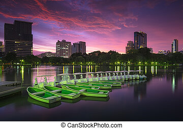 Lake view of Lumpini Park in the Thai capital's city centre with buildings in Bangkok