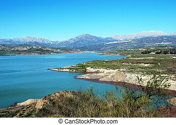 View of Lake Vinuela with mountains to the rear, La Vinuela, Costa del Sol, Malaga Province, Andalusia, Spain, Western Europe.
