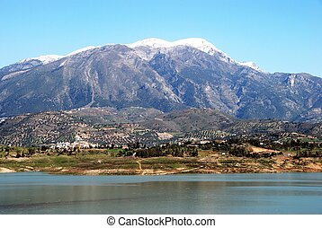 View of Lake Vinuela with snow capped mountains to the rear, La Vinuela, Costa del Sol, Malaga Province, Andalusia, Spain, Western Europe.