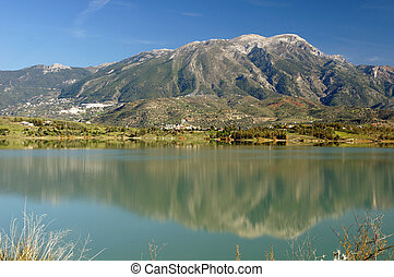 The Axarquia region of Andalucia in Spain: looking across the Embalse de Vinuela towards the mountains of La Maroma and the Sierra Tejadas