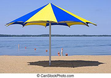 Lake Waconia and Beach - Colorful shade umbrella at sandy...