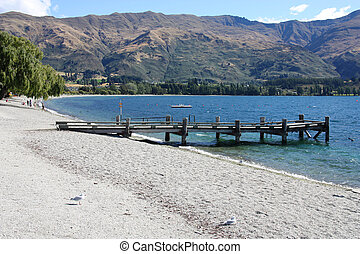 Lake Wanaka in Otago, New Zealand. Beautiful mountain landscape.