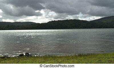 Lake Water and Mountainous Hills - Steady, medium wide shot...