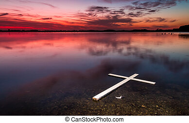Lake White Floating Cross - One white cross floating on a...