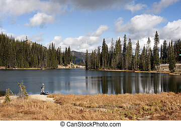 Lake with a fisherman ( Summit Lake in Kootenay Pass)