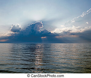 Lake with clouds in sunset