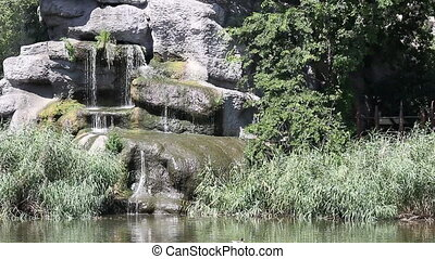 lake with rocks and waterfall
