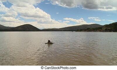Lake With Surrounding Mountains - Handheld, panning,...