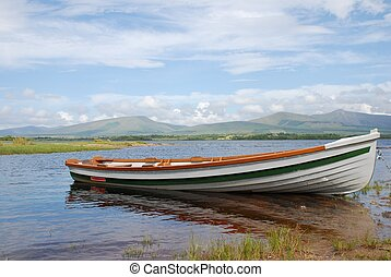 Moored boat on one of the Lakes of Killarney, Co. Kerry, Republic of Ireland, a summers afternoon