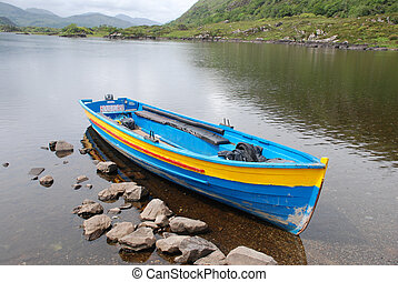 Moored boat on one of the Lakes of Killarney, Co. Kerry, Republic of Ireland, a summers afternoon between the storms