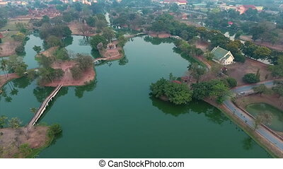 Lakes with bridges and trees around them - A birds eye view...