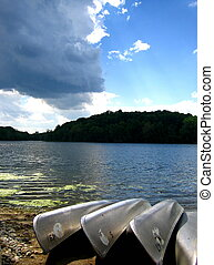 Lakeside Canoes - A photo of some metal canoes resting by...