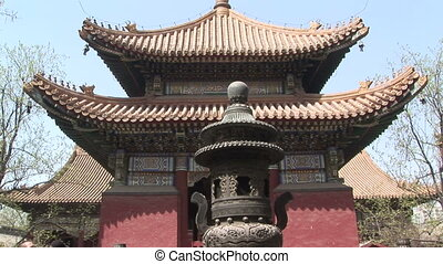Lama Temple Pagoda and Incense Burner - Exterior of a temple...