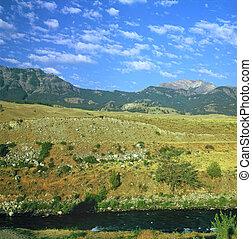 Summer vista of the Lamar River and Absaroka Mountain Range at Gardiner, Montana.