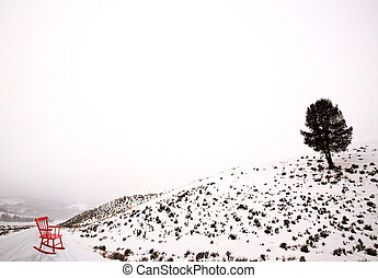 Lamar Valley Winter Yellowstone red chair on road