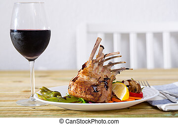 Lamb carre with vegetables and greens - Plate of roasted ...