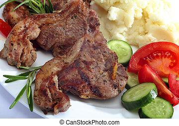 Lamb chop meal close-up