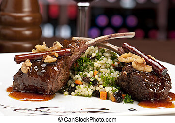 Lamb chops in restaurant - Close up of lamb chops with ...