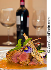 Lamb chops with red wine bottle
