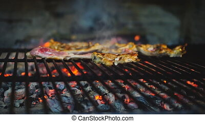 Lamb chops on grill, focus on foreground, plain view