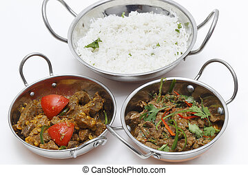 Lamb curries and rice s3erving bowls - A bowl of spiced lamb...