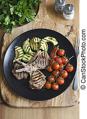 Lamb cutlets with avocado and tomatoes