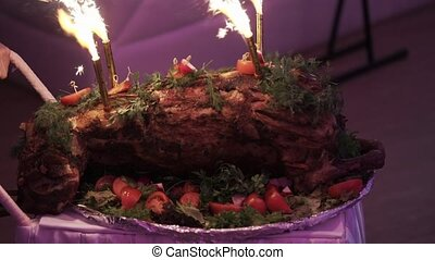 Lamb meat with fireworks at the party