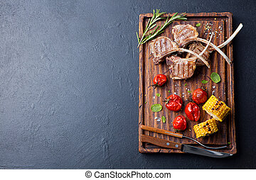 Lamb ribs grilled with roasted vegetables Top view