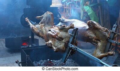 Lamb roasting on a spit
