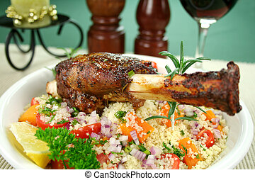 Roasted lamb shank on tomato, butternut pumpkin and parsley couscous.