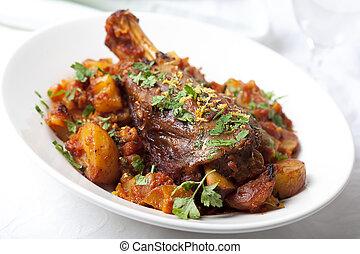 Lamb Shanks - Lamb shank dinner, with vegetables, topped...