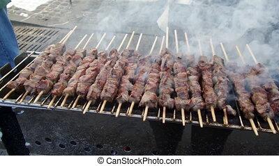 Lamb Skewers - Street food - grilled lamb skewers cooking on...