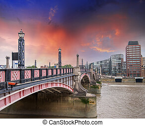 Lambeth Bridge, London. Beautiful red color and surrounding...