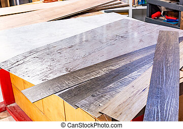 Laminate boards on the table in the workshop