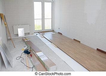 Laminate floor installation - Empty room with laminate floor...
