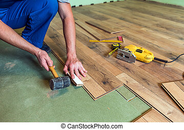 laminate - worker install the laminate floor