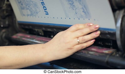 Lamination process of booklet at printing house