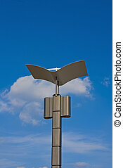 Lamp against a background of blue sky