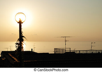Lamp and Setting Sun - Street lamp with sea and setting sun...