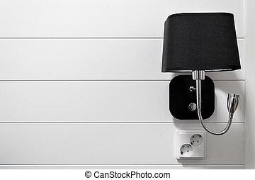 Lamp-bracket on a white wall.