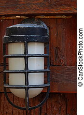 Lamp cover a wooden wall