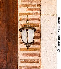Lamp Hanging On A Brick Wall